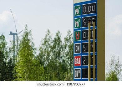Price table at the filling station with the covered part of the decimal number. Prices of gasoline, diesel oil and LPG are visible on the board.