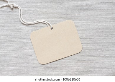 Price tag, brand label mockup on cloth texture background