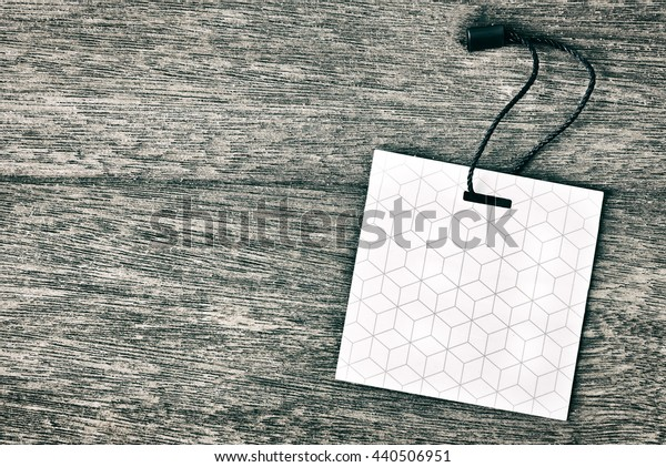 Price tag or label on old wooden table background.