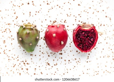 Prickly pear fruit on a abstract white background, creative flat lay food concept, prickly pear cactus, Opuntia ficus-indica