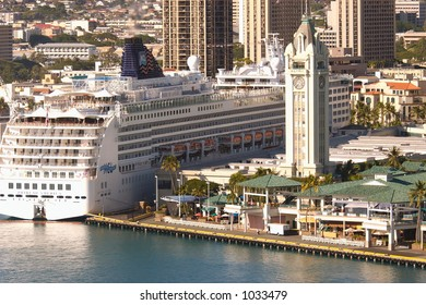 Pride Of America cruise ship docked in Honolulu Harbor at the Aloha Tower Marketplace pier.