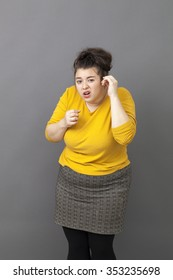 pride and arrogance - overweight young woman standing pretending not hearing, exasperated by critics,grumbling to express her attitude