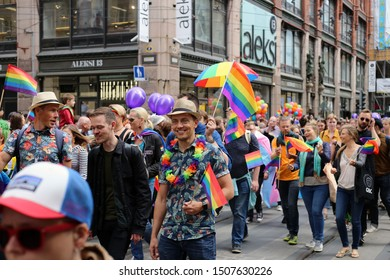 Pride parade of Helsinki, Finland, June 2019. People marching for equality, acceptance and LGBT community rights. In this there is marching people with colorful accessories and rainbow flags.