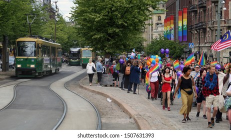 Pride parade of Helsinki, Finland, June 2019. People marching for equality, acceptance and LGBT community rights. In this photo you see marching people with rainbow colored accessories and Stockmann.