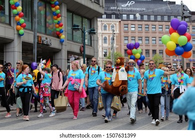 Pride parade of Helsinki, Finland, June 2019. People marching for equality, acceptance and LGBT community rights. In this there is marching people with colorful accessories and some balloons.