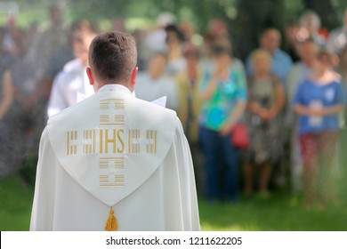 Priest celebrate mass outdoors and empty place for text