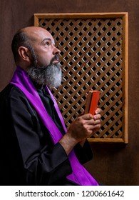 Priest in a confessional.