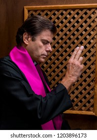 Priest in a confessional