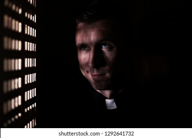 priest in the confessional