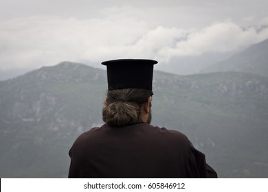 A priest enjoying the view from the Monastery of St. Stephen at Meteora in Greece, on the 23rd of April 2014.
