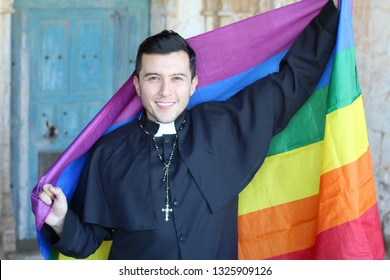 Priest holding the rainbow flag