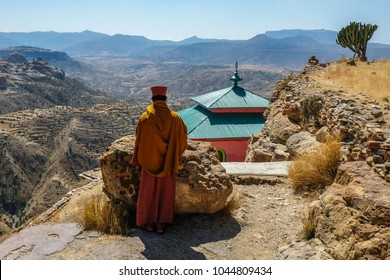 Priest looking over scarp at monastery Debre Damo, near Adigrat in Tigray Region, Ethiopia.