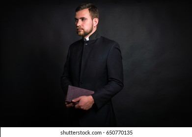 Priest on a dark background