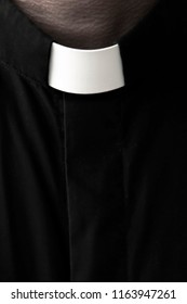 Priest on a dark background. Close-up.