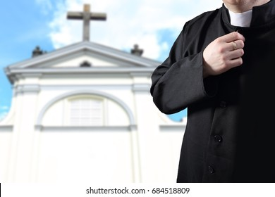 priest praying before the parish