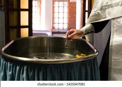 the priest prays over the font, brush and oil of the priest, the sacrament of baptism, Orthodox tradition