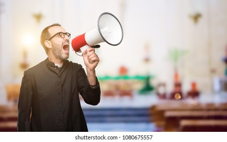 Priest religion man communicates shouting loud holding a megaphone, expressing success and positive concept, idea for marketing or sales at church