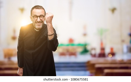 Priest religion man irritated and angry expressing negative emotion, annoyed with someone at church