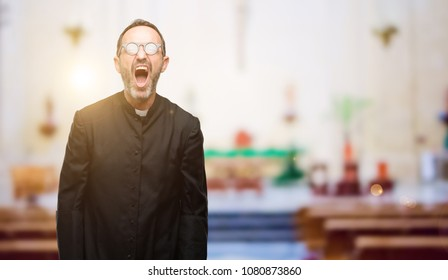 Priest religion man stressful, terrified in panic, shouting exasperated and frustrated. Unpleasant gesture. Annoying work drives me crazy at church