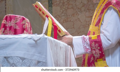 A priest saying the traditional extraordinary tridentine latin rite of the Catholic latin mass