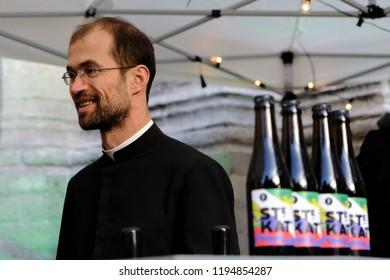 A priest serves beer in Sainte-Catherine church in Brussels, Belgium on Oct. 3, 2018.