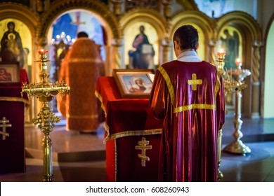 the priest standing with his back to the altar in the temple Orthodox Church