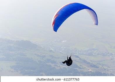 PRILEP, MACEDONIA - circa FEB, 2017: Paraglider flies paraglider in the sky. Paragliding