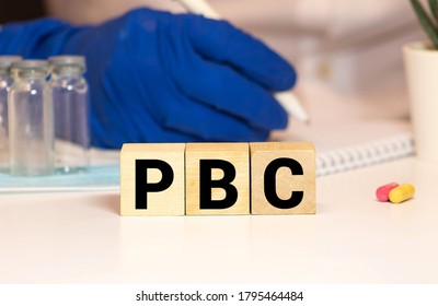Primary Biliary Cirrhosis PBC word, medical term word with medical concepts in blackboard and medical equipment background.