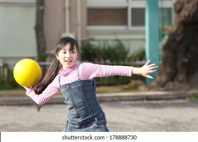 Primary Japanese girl playing dodge ball