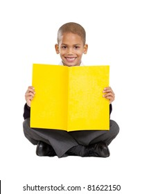 primary schoolboy sitting on floor and reading