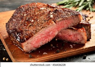 Prime Black Angus Ribeye steak. Medium Rare degree of steak doneness.