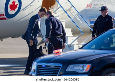 Prime Minister Justin Trudeau greets Calgary Police Service Canine Unit members at the Calgary International Airport as part of his cross country tour on January 25, 2017