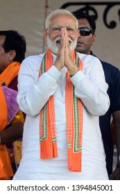Prime Minister Narendra Modi greets Bharatiya Janta Party or BJP supporters during an election campaign for Lok Sabha Election at Barrackpore constituency on April 29, 2019 in Barrackpore, India.