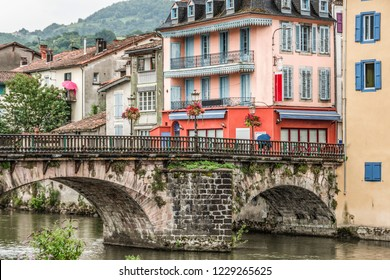 Prime plan of the old bridge over the river Salat and constructions in the central part of the old village of Saint Girons. Ariege France