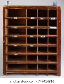Primitive cupboard with open shelves-cells.