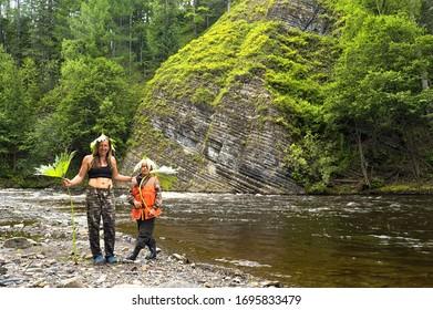 Primorsky krai, Russia - July 22, 2018: Tourists on the mountain river bank. National park Bikin. Zeva river. Ussuri taiga. Primorsky Krai, far East, Russia.