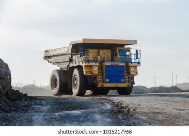 Primorsky Krai, Russia - March 2017: a large dump truck loaded with rocks. BelAZ. dense morning fog