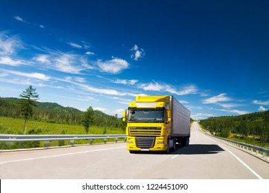 PRIMORYE, RUSSIA - JULY 22, 2012: Yellow DAF XF truck on a road in a sunny day