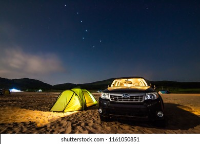 PRIMORYE, RUSSIA - JULY 22, 2018: Subaru Forester at beach camping under Big Dipper constellation