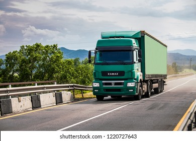 PRIMORYE, RUSSIA - June 6, 2018: Kamaz semi-truck moving over the bridge
