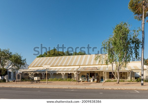 PRINCE ALBERT, SOUTH AFRICA - APRIL 20, 2021: A street scene, with a store in an historic building, in Prince Albert in the Western Cape Province. An ice cream bicycle is visible