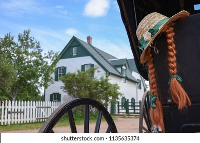 Prince Edward Island, Canada: July, 15th, 2018: A hat and red hair of Anne Shirley on the carriage in front of her house in Green gables heritage, Cavendish.