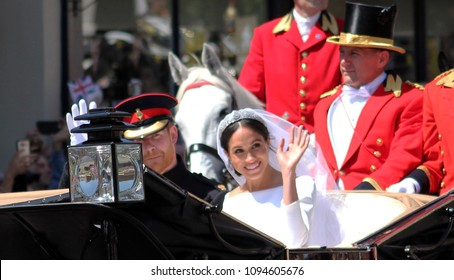 Prince Harry & Meghan Markle, Windsor, Uk - 19/5/2018: Prince Harry and Meghan Markle wedding carriage procession through streets of Windsor then back the Windsor Castle meghan waving to crowd