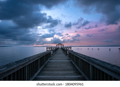 Prince William County, Virginia 6/20/2020: A blue hour morning shot of Leesylvania State Park fishing pier with magenta colored sky.