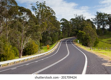 The Princes Highway winds around the countryside near Bega in New South Wales, Australia