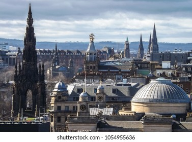 Princes Street, Edinburgh – March 23, 2018: A view across the roof tops and chimney pots of Edinburgh, in the foreground stands the Scott Monument, with church spires on the horizon.