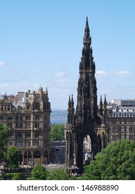 Princes Street, Edinburgh, Scotland.  A view which includes the Scott Monument and  Jenners Department Store, with the Firth of Forth visible in the background.