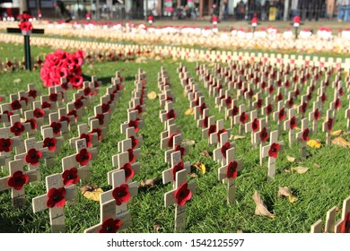 PRINCES STREET GARDENS, EDINBURGH, SCOTLAND - 26 October 2019 Wooden Crosses and Poppies in the Grass on Princes Street Gardens for the Poppy Appeal Ahead of Remembrance Sunday