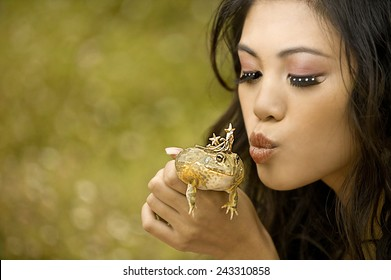 A princess about to kiss her frog prince.
