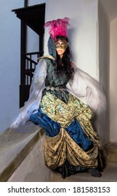 princess in the castle in traditional dress with mask